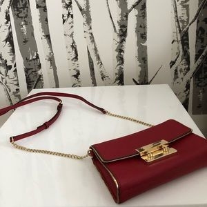 Selling my red and gold Michael Kors crossbody